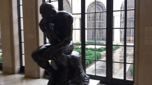 """(replica of) """"Thinker"""" statue by Auguste Rodin, at the Baltimore Art Museum at the Johns Hopkin's University."""